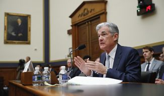 FILE- In this Feb. 27, 2019, file photo Federal Reserve Board Chair Jerome Powell gestures while speaking before the House Committee on Financial Services hearing on Capitol Hill in Washington. On Wednesday, May 1, the Federal Reserve releases its latest monetary policy statement after a two-day meeting. (AP Photo/Pablo Martinez Monsivais, File)