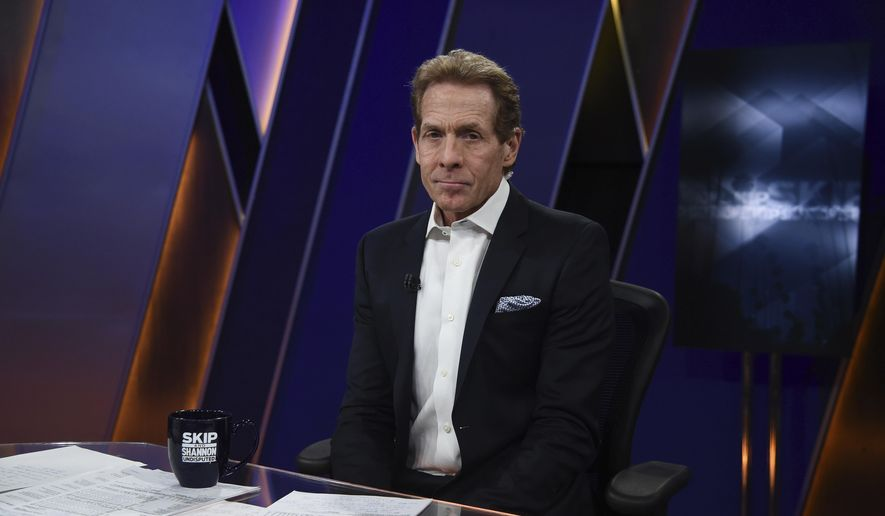 In this 2017 photo provided by Fox Sports, Skip Bayless is shown at Fox Sports Studios in Los Angeles. Fox Sports 1 has built its fortunes around Colin Cowherd and Skip Bayless, but it has also surrounded them with other shows that give the network at least 12 hours of studio programming a day. According to Sports Business Daily, FS1 finished third among the most viewed sports networks last year, behind ESPN and NBCSN but ahead of ESPN2. (Frank Micelotta/Fox Sports via AP)