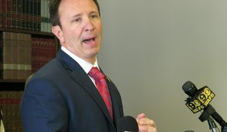 FILE - In this April 1, 2019, file photo, Attorney General Jeff Landry talks about health care legislation he's backing in the upcoming session in Baton Rouge, La. Louisiana lawmakers revived a proposal seeking to recreate federal health law protections for people with pre-existing health conditions in state law. (AP Photo/Melinda Deslatte, File)