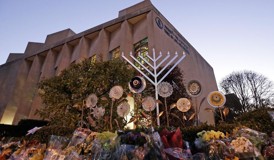 """File - In this Sunday, Dec. 2, 2018 file photo, a menorah is installed outside the Tree of Life Synagogue in preparation for a celebration service at sundown on the first night of Hanukkah, in the Squirrel Hill neighborhood of Pittsburgh. A gunman shot and killed 11 people while they worshipped Saturday, Oct. 27, 2018 at the temple. Israeli researchers reported Wednesday that violent attacks against Jews spiked significantly last year, with the largest reported number of Jews killed in anti-Semitic acts in decades, leading to an """"increasing sense of emergency"""" among Jewish communities worldwide. (AP Photo/Gene J. Puskar, File)"""