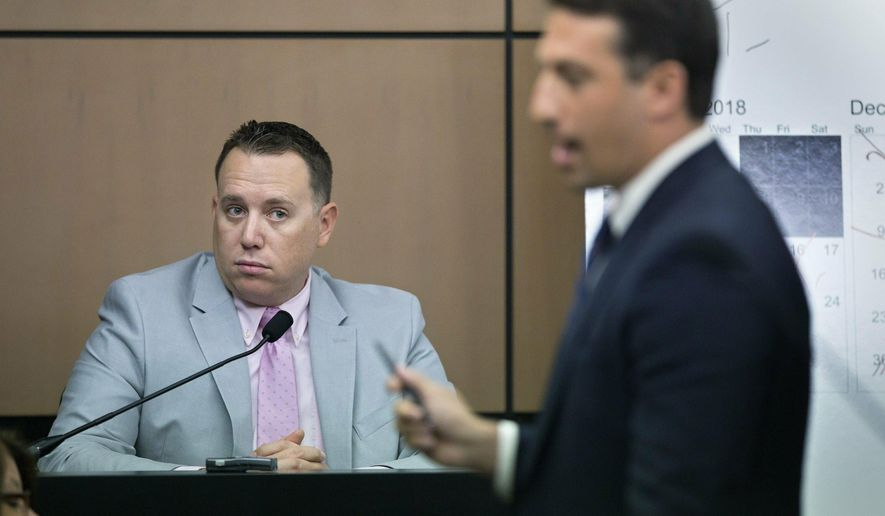 Jupiter Police Detective Andrew Sharp is questioned by Alex Spiro, right, attorney for New England Patriots owner Robert Kraft, during a motion hearing in the Kraft prostitution solicitation case, Wednesday, May 1, 2019, in West Palm Beach, Fla. Kraft's attorneys argue that undercover surveillance videos allegedly showing their client paying for sex at a Jupiter day spa should be ruled inadmissible and the evidence thrown out. (Lannis Waters/Palm Beach Post via AP, Pool)