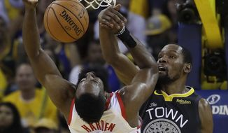 Golden State Warriors' Kevin Durant, right, defends against Houston Rockets' James Harden (13) during the second half in Game 2 of a second-round NBA basketball playoff series in Oakland, Calif., Tuesday, April 30, 2019. (AP Photo/Jeff Chiu) **FILE**