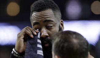 Houston Rockets' James Harden wipes his injured eye with a towel during the first half of Game 2 of the team's second-round NBA basketball playoff series against the Golden State Warriors in Oakland, Calif., Tuesday, April 30, 2019. (AP Photo/Jeff Chiu) ** FILE **