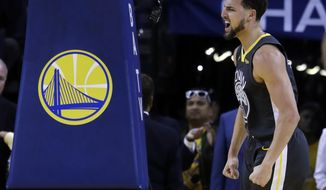 Golden State Warriors' Klay Thompson reacts after scoring against the Houston Rockets during the first half of Game 2 of a second-round NBA basketball playoff series in Oakland, Calif., Tuesday, April 30, 2019. (AP Photo/Jeff Chiu)