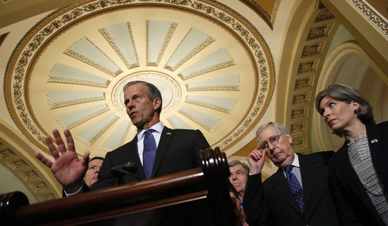 Senate Majority Whip John Thune, R-S.D., joined by Senate Majority Leader Mitch McConnell of Ky., second from right, and Sen. Joni Ernst, R-Iowa, speaks to members of the media following a Senate policy luncheon, Tuesday, April 30, 2019, on Capitol Hill in Washington. (AP Photo/Patrick Semansky)