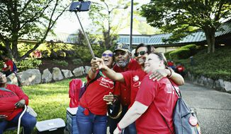 From left, Shannon Daniels, Willie Ramey, Dee Grisset and Amy Harrison take a selfie in the parking lot of The N.C. Association of Educators in downtown Raleigh, N.C., before the start of the teacher's march and rally, Wednesday, May 1, 2019. North Carolina teachers took to the streets Wednesday for the second year in a row with hopes that a more politically balanced legislature will be more willing to meet their demands. (Juli Leonard/The News & Observer via AP)