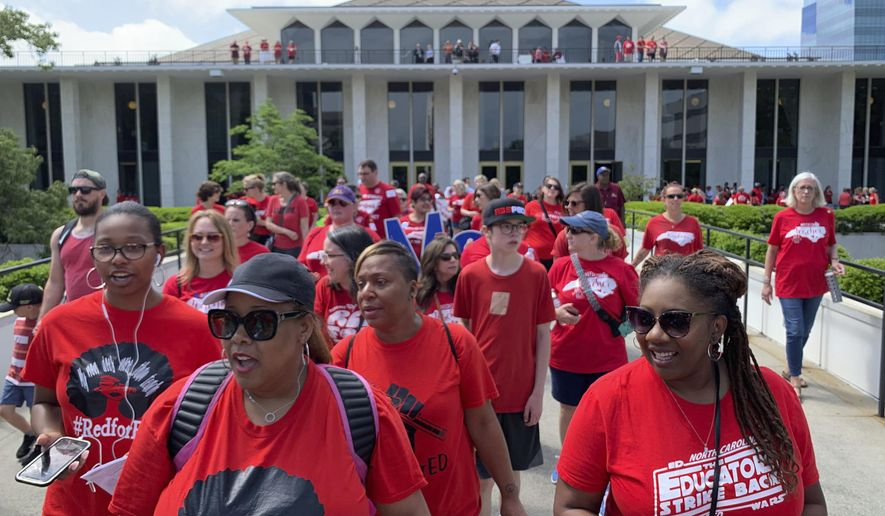 Teachers and their supporters marched on the state capitol in Raleigh, N.C., on Wednesday, May 1, 2019, to demand better funding in schools, increased salaries, the expansion of Medicaid, and better mental health services in schools, among other things. (AP Photo/Amanda Morris)