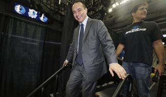FILE - In this Aug. 15, 2013, file photo, Dallas Mavericks general manager Gersson Rosas walks off the stage after an NBA basketball news conference in Dallas. A person with knowledge of the process tells The Associated Press that the Minnesota Timberwolves have decided to hire Rosas as president of basketball operations. The person spoke on condition of anonymity Wednesday, May 1, because the team had yet to announce the hire of Rosas, who has been a finalist for the top job with several other NBA teams. He had a three-month stint as general manager of the Mavericks in 2013, before resigning and returning to the Rockets, (AP Photo/LM Otero, File)