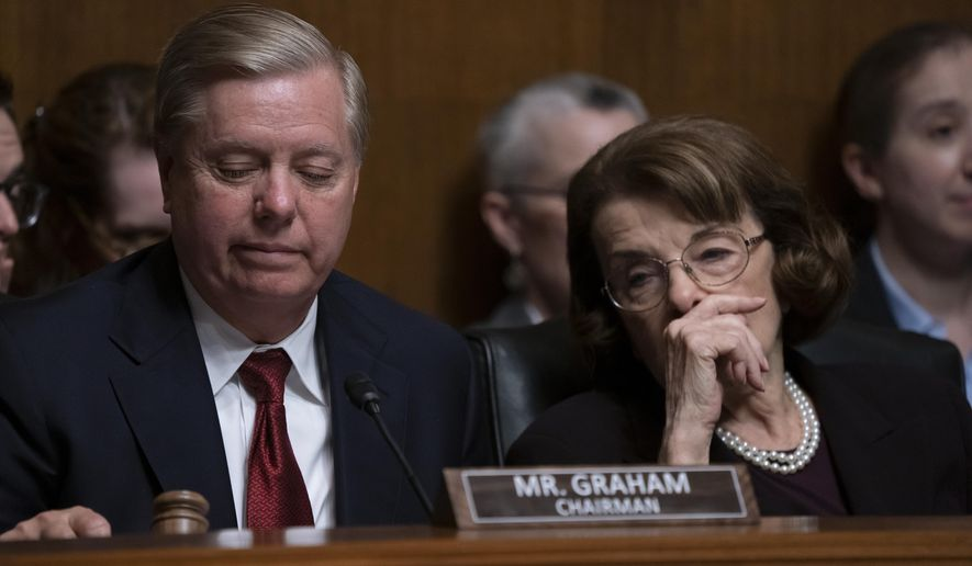 Senate Judiciary Committee Chairman Lindsey Graham, R-S.C., left, and Sen. Dianne Feinstein, D-Calif., the ranking member, prepare to take a break during a hearing on Capitol Hill in Washington, Wednesday, May 1, 2019. (AP Photo/J. Scott Applewhite) ** FILE **
