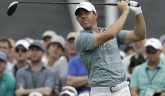 FILE - In this April 13, 2019, file photo, Rory McIlroy, of Northern Ireland, hits a drive on the first hole during the third round for the Masters golf tournament, in Augusta, Ga. McIlroy is at the Wells Fargo Championship this week in Charlotte, N.C., where he turns 30 on Saturday, May 4. (AP Photo/Marcio Jose Sanchez, File)
