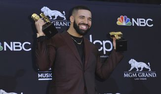 "Drake poses in the press room with his awards at the Billboard Music Awards on Wednesday, May 1, 2019, at the MGM Grand Garden Arena in Las Vegas. Drake won for top artist, top male artist, top billboard 200 artist, top hot 100 artist, top streaming songs artist, top song sales artist, top radio songs artist, top rap artist, top rap male artist, top billboard 200 album and top rap album for ""Scorpion,"" and top streaming song video for ""In My Feelings.""(Photo by Richard Shotwell/Invision/AP)"