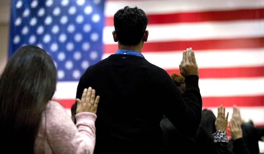 People take the oath of citizenship in Los Angeles. Most voters say the citizenship question should be included on the 2020 census. (Associated Press)