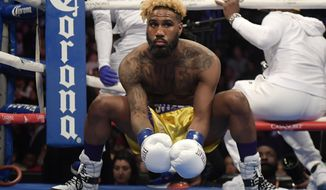 Jarrett Hurd stretches before during a WBA-IBF-IBO junior middleweight championship boxing match against Jason Welborn, of England, Saturday, Dec. 1, 2018, in Los Angeles. (AP Photo/Mark J. Terrill)