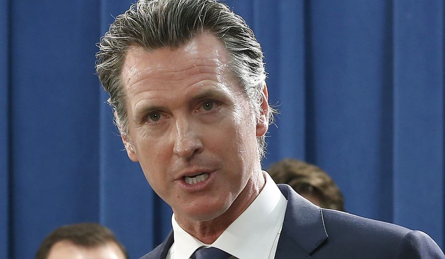 In this Monday April 29, 2019 photo, Gov. Gavin Newsom talks to reporters at the Capitol in Sacramento, Calif. Newsom officially abandoned the plan of his predecessor, Gov. Jerry Brown, to build giant 35-mile twin tunnels to ship water through the Sacramento-San Joaquin River Delta to Southern California, Thursday, May 2, 2019. Instead Newsom is opting to build a single tunnel with a different design and a lower price. (AP Photo/Rich Pedroncelli)
