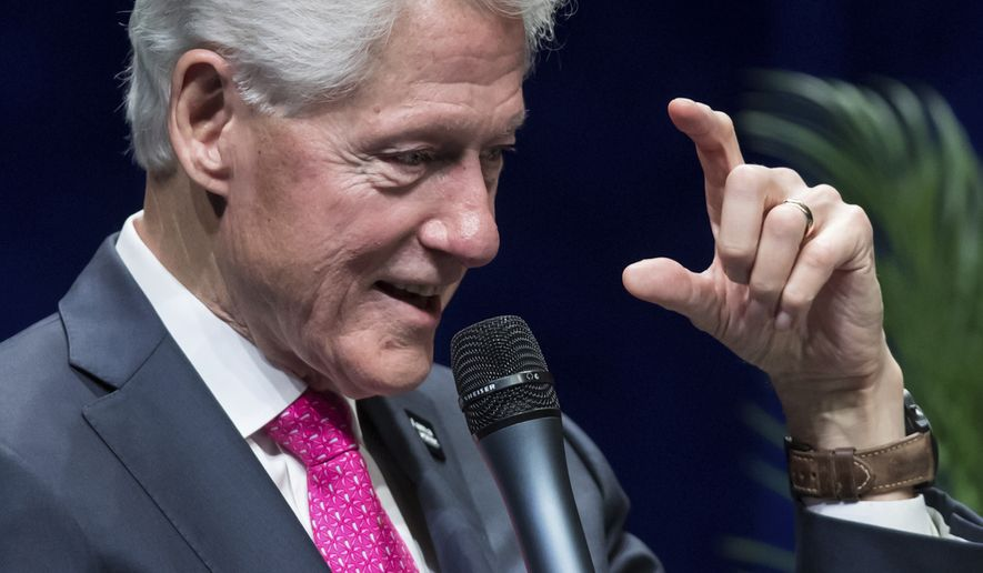 Former U.S. President Bill Clinton speaks during a question and answer conversation with his wife, former U.S. Secretary of State Hillary Clinton, as part of their North American tour in Vancouver, British Columbia, on Thursday, May 2, 2019. (Darryl Dyck/The Canadian Press via AP)