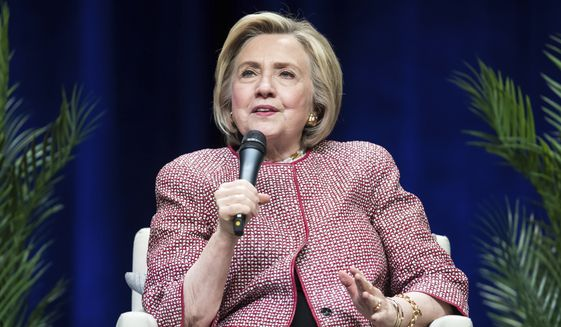 Former U.S. Secretary of State Hillary Clinton, speaks during a question-and-answer conversation with her husband, former U.S. President Bill Clinton, as part of their North American tour in Vancouver, British Columbia, on Thursday, May 2, 2019. (Darryl Dyck/The Canadian Press via AP) ** FILE **