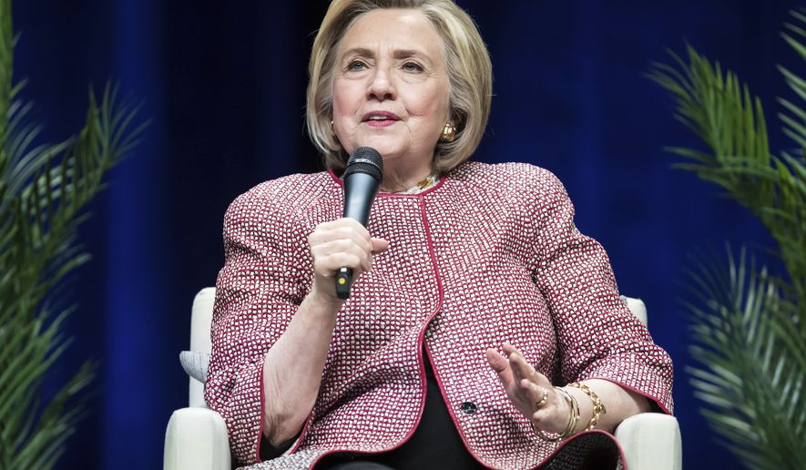 Former U.S. Secretary of State Hillary Clinton, speaks during a question and answer conversation with her husband, former U.S. President Bill Clinton, as part of their North American tour in Vancouver, British Columbia, on Thursday, May 2, 2019. (Darryl Dyck/The Canadian Press via AP)