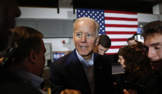Former Vice President and Democratic presidential candidate Joe Biden greets audience members during a rally, Tuesday, April 30, 2019, in Cedar Rapids, Iowa. (AP Photo/Charlie Neibergall)