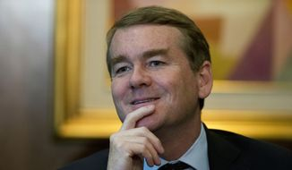 In this July 4, 2017, file photo, Sen. Michael Bennet, D-Colo., listens during a question-and-answer session with a small group of journalists at a hotel, as he visits Mexico City. (AP Photo/Rebecca Blackwell) ** FILE **