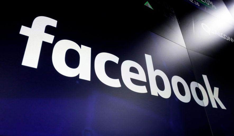 In this March 29, 2018, file photo, the logo for social media giant Facebook, appears on screens at the Nasdaq MarketSite, in New York's Times Square. (AP Photo/Richard Drew, File)