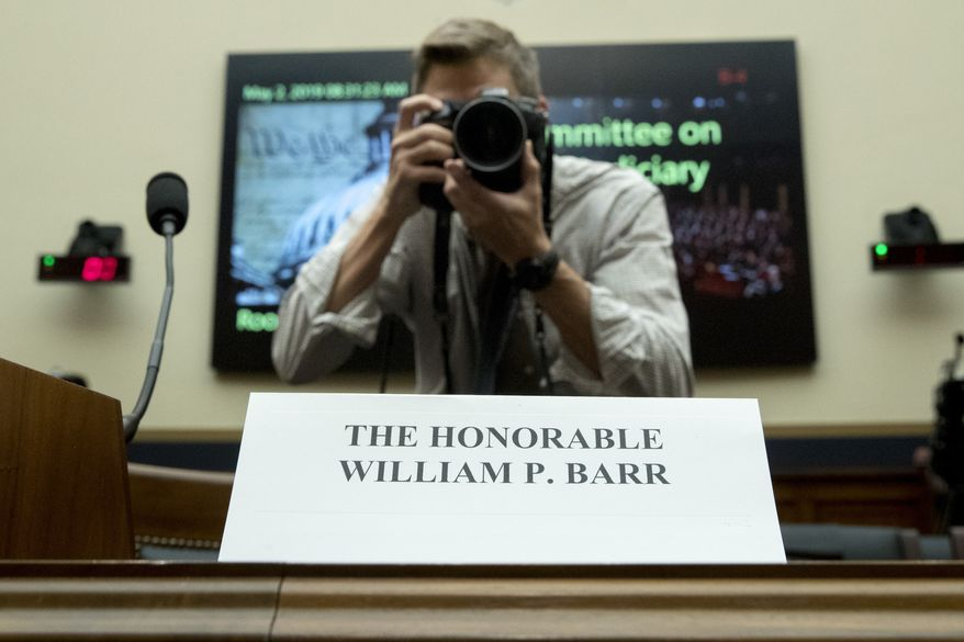 A photographer takes a photograph of a placard for Attorney General William Barr who is not expected to appear before a House Judiciary Committee hearing on Capitol Hill in Washington, Thursday, May 2, 2019. (AP Photo/Andrew Harnik)