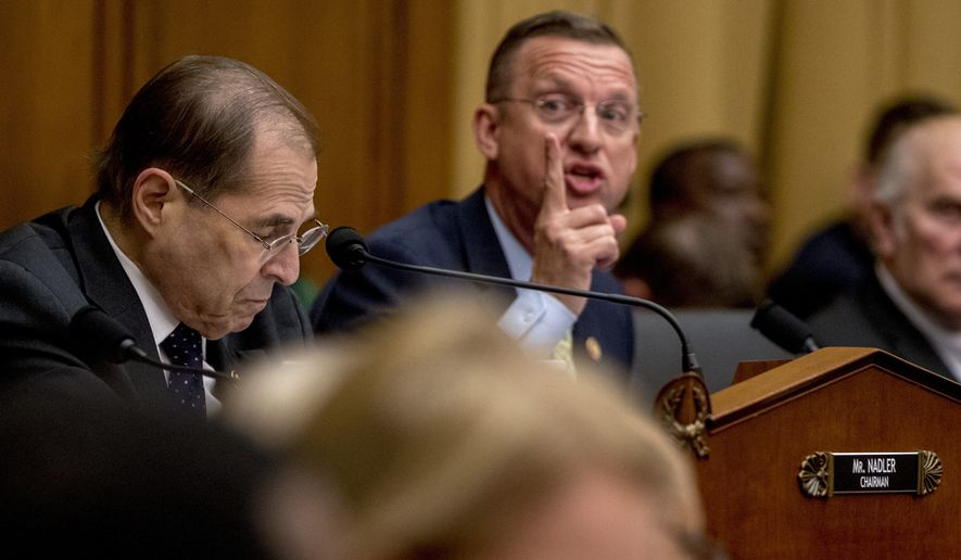 Ranking Member Rep. Doug Collins, R-Ga., center, accompanied by Judiciary Committee Chairman Jerrold Nadler, D-N.Y., left, speaks as Attorney General William Barr does not appear before a House Judiciary Committee hearing on Capitol Hill in Washington, Thursday, May 2, 2019.  (AP Photo/Andrew Harnik)
