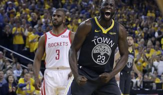 Golden State Warriors' Draymond Green (23) reacts after scoring, in front of Houston Rockets' Chris Paul (3) during the second half of Game 2 of a second-round NBA basketball playoff series in Oakland, Calif., Tuesday, April 30, 2019. (AP Photo/Jeff Chiu)