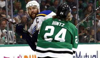 St. Louis Blues' Alex Pietrangelo is checked by Dallas Stars' Roope Hintz (24), of Finland, during the first period in Game 4 of an NHL second-round hockey playoff series Wednesday, May 1, 2019, in Dallas. (AP Photo/Tony Gutierrez)