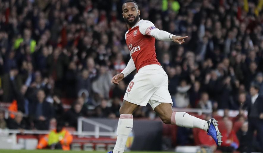 Arsenal's Alexandre Lacazette celebrates after scoring his side's first goal during the Europa League semifinal first leg soccer match between Arsenal and Valencia at the Emirates stadium in London, Thursday, May 2, 2019. (AP Photo/Kirsty Wigglesworth)