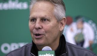 In this June 23, 2017, file photo, Boston Celtics team president Danny Ainge speaks at the team's practice facility in Waltham, Mass. The Celtics said that Ainge suffered a mild heart attack Tuesday night, April 30, 2019, in Milwaukee, where the team played the Bucks in the second round of the NBA playoffs. The team said he received immediate medical attention and is expected to make a full recovery. (AP Photo/Charles Krupa, File) **FILE**