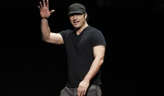 FILE - This April 26, 2018 file photo shows director Robert Rodriguez waving to the audience during the 20th Century Fox presentation at CinemaCon 2018 in Las Vegas. Cirque du Soleil is planning a new live show for the Las Vegas Strip this fall, written by Rodriguez. (Photo by Chris Pizzello/Invision/AP, File)