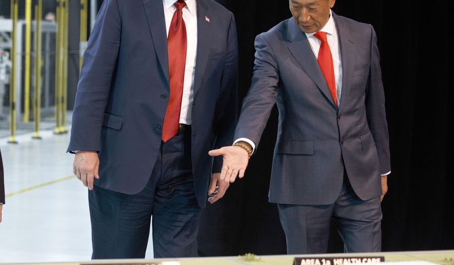 FILE - In this Thursday, June 28, 2018, file photo, President Donald Trump, left, takes a tour of Foxconn with Foxconn chairman Terry Gou in Mt. Pleasant, Wis. Gou says the Taiwanese company is moving forward with its plan to build a manufacturing facility in Wisconsin and President Donald Trump has promised to visit when production starts next year. Gou met with Trump on Wednesday to discuss the ever-changing project. Foxconn, the world's largest electronics company whose customers include Apple, Amazon and Google, plans to build a display screen factory in southeast Wisconsin. (AP Photo/Evan Vucci, File)