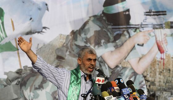 File - In this Friday, Oct. 21, 2011 file photo, Yehiyeh Sinwar, a founder of Hamas' military wing, talks during a rally in Khan Younis, southern Gaza Strip, . Sinwar left for talks with Egyptian officials Thursday after a new outbreak of violence, as Hamas accuses Israel of slowing down the implementation of Egyptian-mediated understandings aimed at easing the situation in the Palestinian enclave and paving the way for a cease-fire. (AP Photo/Hatem Moussa, File)
