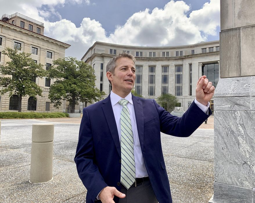 Former Alabama legislator Ed Henry smiles as he speaks with reporters on Thursday, May 2, 2019 outside the federal courthouse in Montgomery, Ala. A federal judge has sentenced Henry to two years of probation for his role in a health care fraud case. (AP Photo/Kim Chandler)