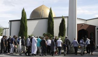 FILE - In this Saturday, March 23, 2019 file photo, Worshippers prepare to enter the Al Noor mosque following last week's mass shooting in Christchurch, New Zealand. The death toll from the Christchurch mosque attacks has risen to 51 after a Turkish man who had been hospitalized since a gunman opened fire on worshippers seven weeks ago died overnight, authorities in New Zealand and Turkey confirmed, Friday, May 3, 2019. (AP Photo/Mark Baker, File)