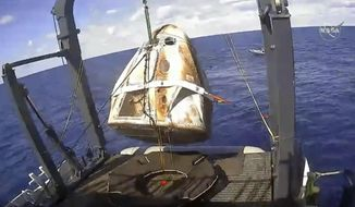 FILE - In this March 8, 2019 file image taken from video made available by NASA, the SpaceX Crew Dragon capsule is hoisted onto a ship in the Atlantic Ocean off the Florida coast after it returned from a mission to the International Space Station. SpaceX said Thursday, May 2, 2019, that their Dragon capsule for astronauts, which flew without a crew to the International Space Station last month, was destroyed during a ground test on April 20, 2019, in Cape Canaveral, Fla. (NASA via AP, File)