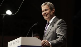 FILE - In this Friday, Jan. 18, 2019 file photo, Tennessee Gov.-elect Bill Lee takes part in a walk-through for his inauguration in War Memorial Auditorium in Nashville, Tenn. Gov. Bill Lee has signed legislation that would likely make Tennessee the first to fine voter registration groups for turning in too many incomplete signup forms. It drew an immediate federal lawsuit. Tennessee's NAACP chapter and other voter registration groups sued after Lee signed the bill Thursday, May 2, 2019 backed by Republican Secretary of State Tre Hargett. Groups submitting 100-plus incomplete registrations over a year could be fined. (AP Photo/Mark Humphrey, File)