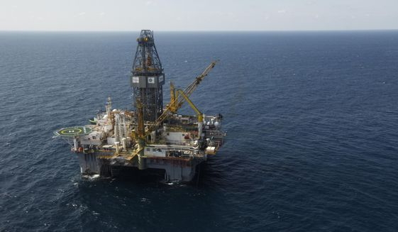 In this Sept. 18, 2010, file photo, rhe Development Driller III, which drilled the relief well and pumped the cement to seal the Macondo well, the source of the Deepwater Horizon rig explosion and oil spill, is seen in the Gulf Of Mexico, off the coast of Louisiana. The Trump administration on Thursday, May 2, 2019, moved to ease safety regulations adopted after the 2010 BP Deepwater Horizon blowout, the worst offshore oil disaster in U.S. history that killed nearly a dozen people. (AP Photo/Gerald Herbert, File)