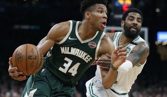 Milwaukee Bucks' Giannis Antetokounmpo (34) drives past Boston Celtics' Kyrie Irving during the first half of Game 3 of a second round NBA basketball playoff series in Boston, Friday, May 3, 2019. (AP Photo/Michael Dwyer)