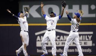 Milwaukee Brewers' Lorenzo Cain (6), Ben Gamel (16), and Ryan Braun celebrate the team's 3-1 win over the New York Mets in a baseball game Friday, May 3, 2019, in Milwaukee. (AP Photo/Aaron Gash)