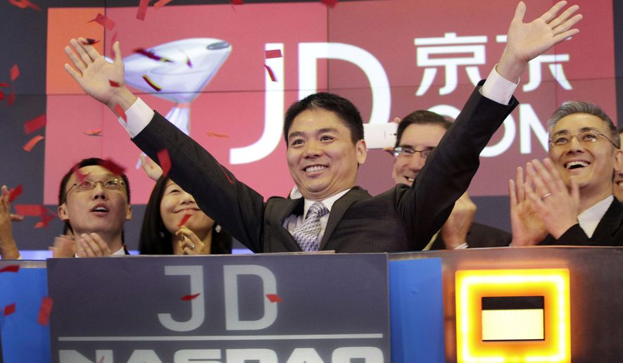 FILE - In this file photo taken May 22, 2014, Liu Qiangdong, also known as Richard Liu, CEO of JD.com, raises his arms to celebrate the IPO for his company at the Nasdaq MarketSite, in New York. Six Chinese social media accounts have been shut down after advocating support for a woman who has accused JD.com founder Richard Liu of rape. (AP Photo/Mark Lennihan, File)
