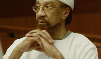 FILE- In this March 11, 2002 file photo, Jamil Abdullah Al-Amin watches during the sentencing portion of his trial in Atlanta. Al-Amin, the militant civil rights leader known in the 1960s as H. Rap Brown who was convicted of killing Fulton County Sheriff's Deputy Ricky Kinchen and wounding Deputy Aldranon English in a shootout in March 2000,  is challenging his imprisonment, saying his constitutional rights were violated at trial.  (AP Photo/Ric Feld, File)