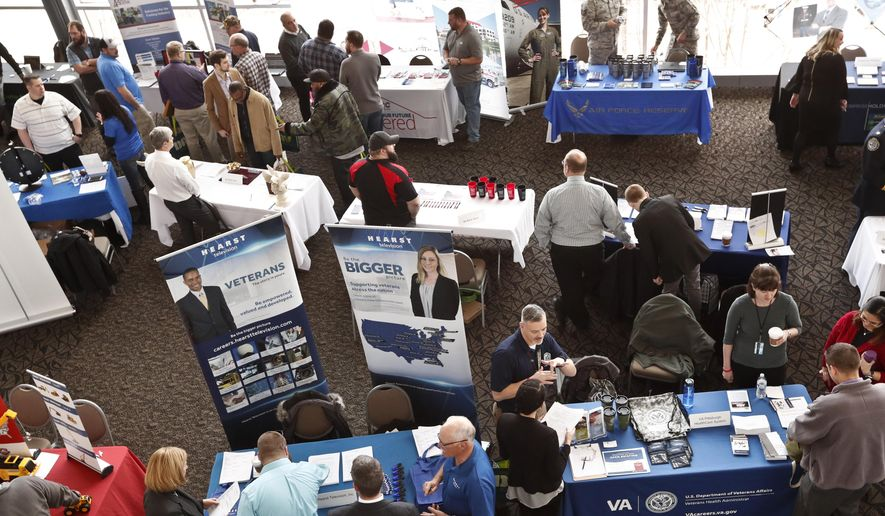 In this March 7, 2019, file photo, visitors to the Pittsburgh veterans job fair meet with recruiters at Heinz Field in Pittsburgh. (AP Photo/Keith Srakocic, File)