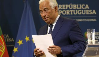Portuguese Prime Minister Antonio Costa leaves after addressing the country from the Sao Bento palace, the premier's official residence, in Lisbon, Friday, May 3, 2019.(AP Photo/Armando Franca)