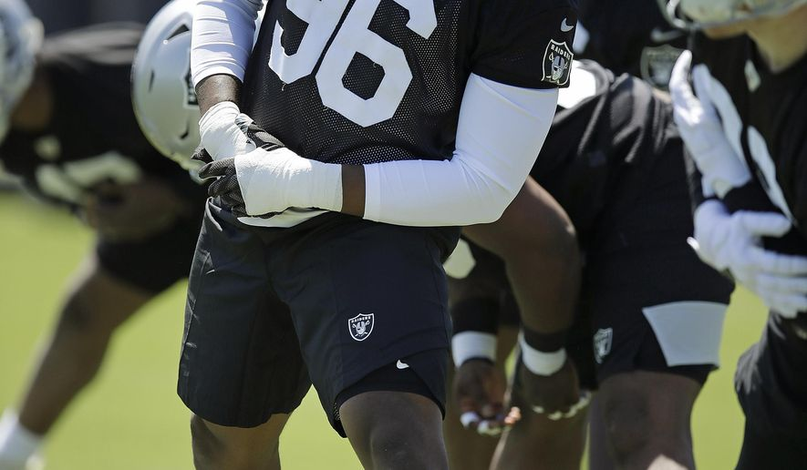 Oakland Raiders defensive end Clelin Ferrell performs a drill during an NFL football practice on Friday, May 3, 2019, at the team's training facility in Alameda, Calif. (AP Photo/Ben Margot)