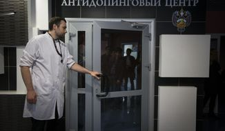 FILE - In this Tuesday, May 24, 2016 file photo, Grigory Dudko opens a door for journalists during a visit to Russia's national drug-testing laboratory in Moscow, Russia. The Moscow laboratory which was shut down in 2015 following doping cover-ups has quietly become a crucial part of the world's drug-testing system once again. (AP Photo/Alexander Zemlianichenko, File)