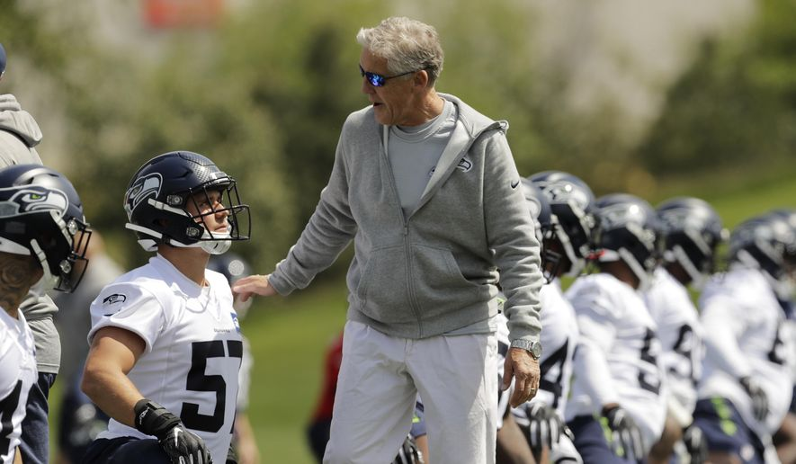 4b2a1596 Seattle Seahawks coach Pete Carroll, center, talks with rookie linebacker  Cody Barton, left