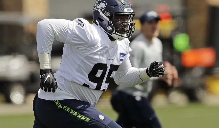 f97b9a36 Seattle Seahawks defensive end L.J. Collier runs a drill during NFL football  rookie minicamp, Friday