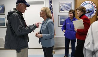 Secretary of the Navy Richard V. Spencer, left, speaks with Sen. Maggie Hassan, D-NH, after a news conference at the Portsmouth Naval Shipyard, Friday, May, 3, 2019, in Kittery, Maine. Members of Maine and New Hampshire's congressional delegations, including Sen. Susan Collins, R-Maine, and Sen. Jeanne Shaheen, D-NH, at right, have been working to prevent shipyard construction projects from being cut to fund President Donald Trump's wall at the southern border. (AP Photo/Robert F. Bukaty)