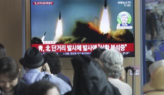 "People watch a TV showing a file footage of North Korea's missile launch during a news program at the Seoul Railway Station in Seoul, South Korea, Saturday, May 4, 2019. North Korea on Saturday fired several unidentified short-range projectiles into the sea off its eastern coast, the South Korean Joint Chiefs of Staff said, a likely sign of Pyongyang's growing frustration at stalled diplomatic talks with Washington meant to provide coveted sanctions relief in return for nuclear disarmament. The signs read: "" North Korea fired short-range missiles."" (AP Photo/Ahn Young-joon)"